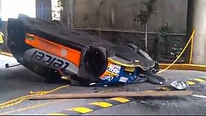 Race car rolls off lift