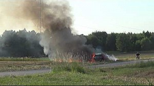 Rally car starts massive grass fire in Polish rally