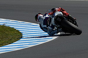MotoGP Qualifying report Lorenzo emerges from the clouds to take pole position at Motegi
