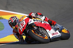 MotoGP Qualifying report Marquez smashes lap record for pole position at Valencia