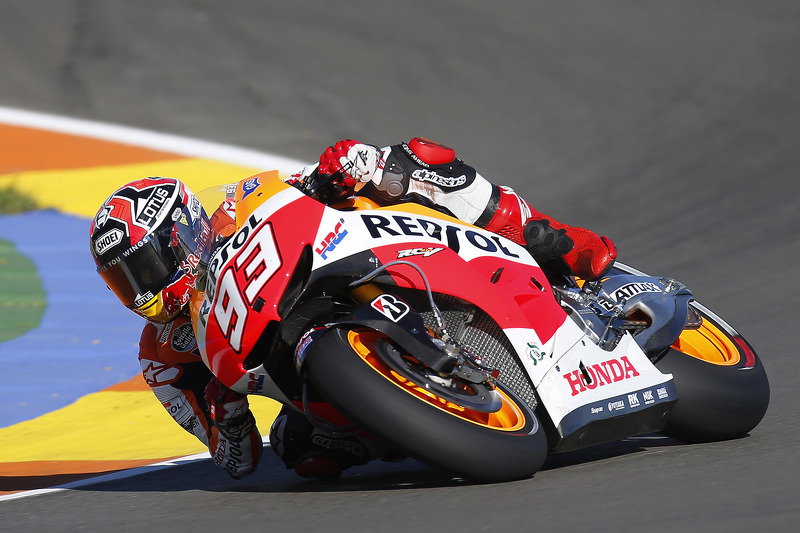 Marquez smashes lap record for pole position at Valencia