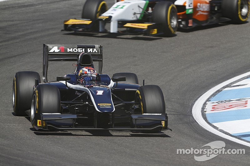 Evans hangs on to win dramatic 200th feature race at Hockenheim