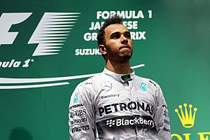 Formula 1 Breaking news Mercedes' Lewis Hamilton wins safety car and rain delayed Japanese Grand Prix