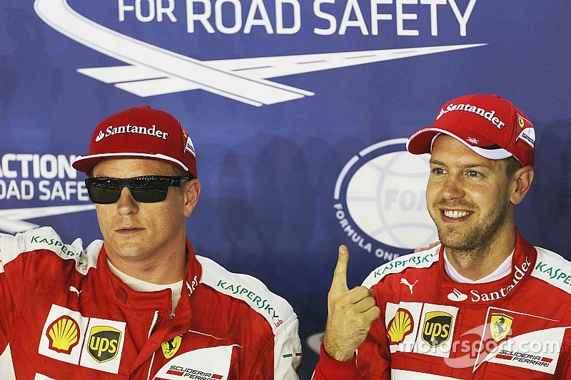 "Singapore Grand Prix: Vettel takes his first pole in ""red"""