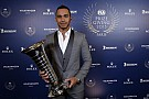 Hamilton collects F1 championship trophy at FIA Gala