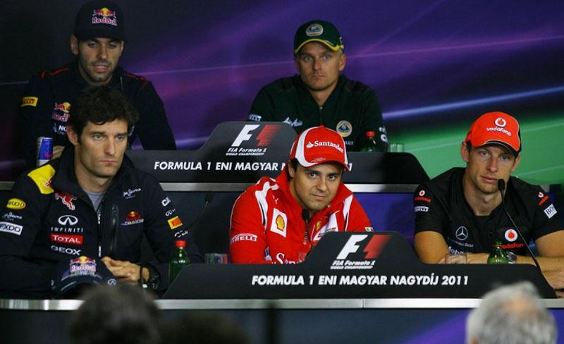 Webber, Massa e Button durante coletiva da FIA