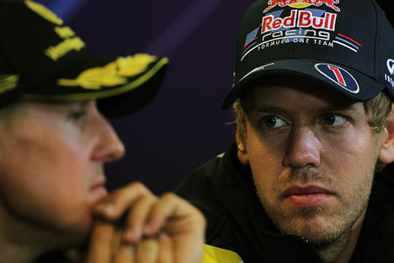 Vettel junto de Schumacher durante coletiva na Bélgica