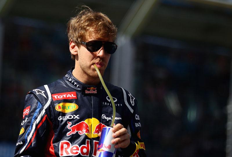 Vettel: muita água para encarar o calor malaio