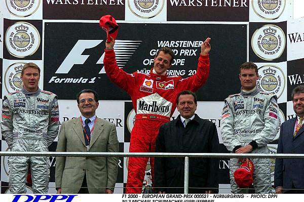 F1 2000 - EUROPEAN GRAND-PRIX 000521 - NURBURGRING - PHOTO: DPPI N¡ 3 MICHAEL SCHUMACHER (GER)/FERRARI N¡1 MIKA HAKKINEN (FIN)/MC LAREN-MERCEDES PODIUM