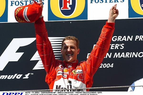 AUTO - F1 2004 - SAN MARINO GP - IMOLA 20040425 - PHOTO : GILLES LEVENT / DPPI N° 1 - MICHAEL SCHUMACHER (GER) / FERRARI - AMBIANCE - PORTRAIT_PODIUM