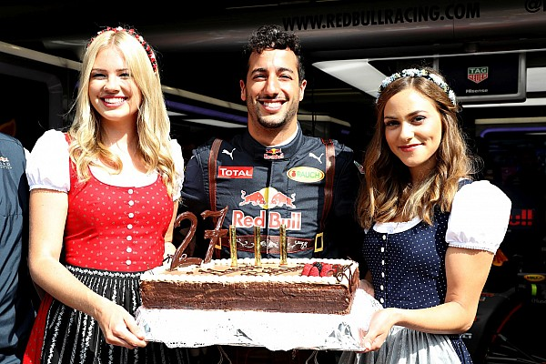 SPIELBERG, AUSTRIA - JULY 01: Daniel Ricciardo of Australia and Red Bull Racing celebrates his 27th birthday with a cake and a couple of girls dressed in traditional Austrian dirndl dresses before practice for the Formula One Grand Prix of Austria at Red Bull Ring on July 1, 2016 in Spielberg, Austria. (Photo by Mark Thompson/Getty Images)