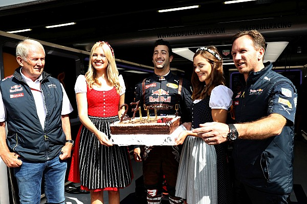 SPIELBERG, AUSTRIA - JULY 01: Daniel Ricciardo of Australia and Red Bull Racing celebrates his 27th birthday with a cake, Red Bull Racing Team Consultant Dr Helmut Marko, Red Bull Racing Team Principal Christian Horner and a couple of girls dressed in traditional Austrian dirndl dresses before practice for the Formula One Grand Prix of Austria at Red Bull Ring on July 1, 2016 in Spielberg, Austria. (Photo by Mark Thompson/Getty Images)