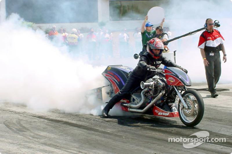 Tony Mattioli does a smoky burn-out to prepare the bike to run in Nitro Harley; Mattioli took the win