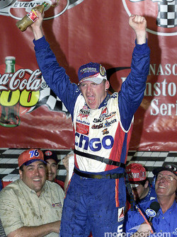 A jubilant Jeff Burton celebrates his first win of the 2001 season