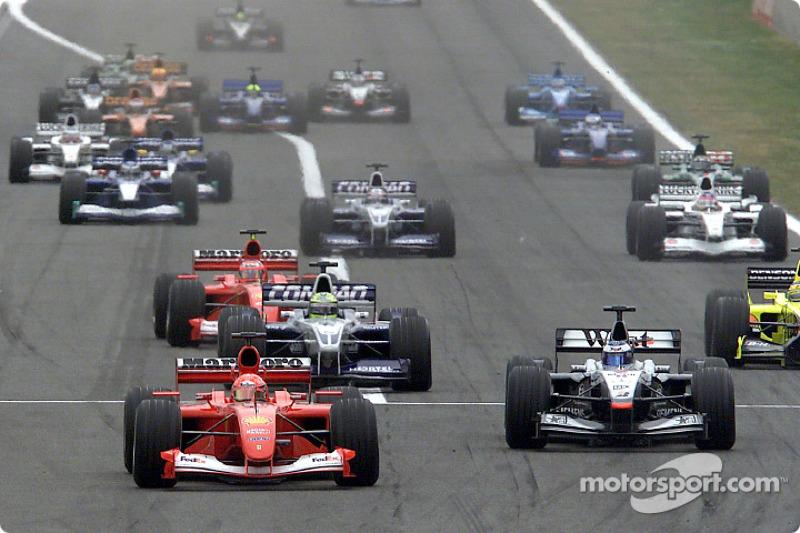 The start: Michael Schumacher and Mika Hakkinen leading the way