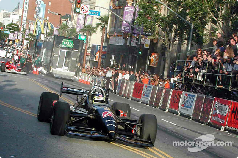 CART driver Cristiano da Matta roars down Hollywood Blvd in his CART 101 car on way to 'Driven' remiere.