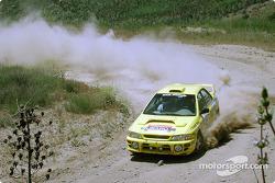 Paul Eklund and Scott Huhn in a Subaru Impreza