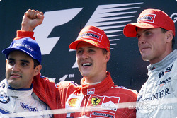 The podium: Juan Pablo Montoya, Michael Schumacher and David Coulthard