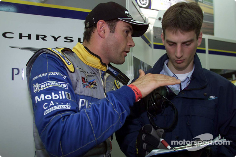 Karl Wendlinger explains the handling of his Team Playstation Chrysler LMP to the engineers