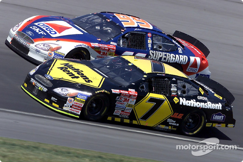 Robby Gordon and Jeff Burton race side by side