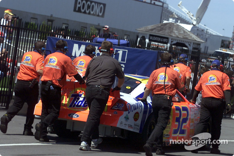 The Tide Ford Taurus of Ricky Craven is pushed through the garage at Pocono