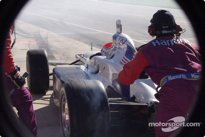 Greg Ray leaving the pits, notice the left rear tire