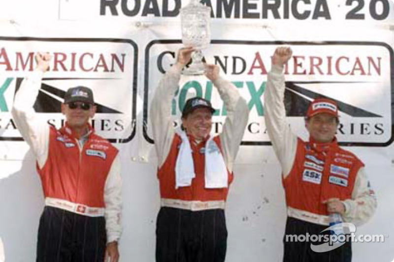 Fredy Lienhard, Didier Theys and Mauro Baldi celebrate the Doran Lista Racing team's first win of the season