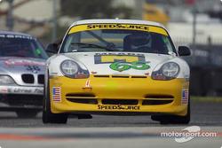 The #65 Speedsource Porsche passes a slower ST car
