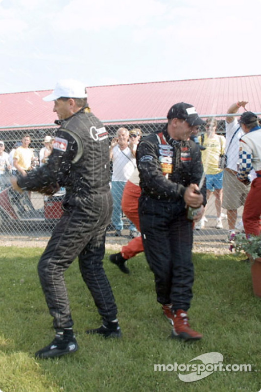 Archangel Motorsport Services drivers celebrate with champagne
