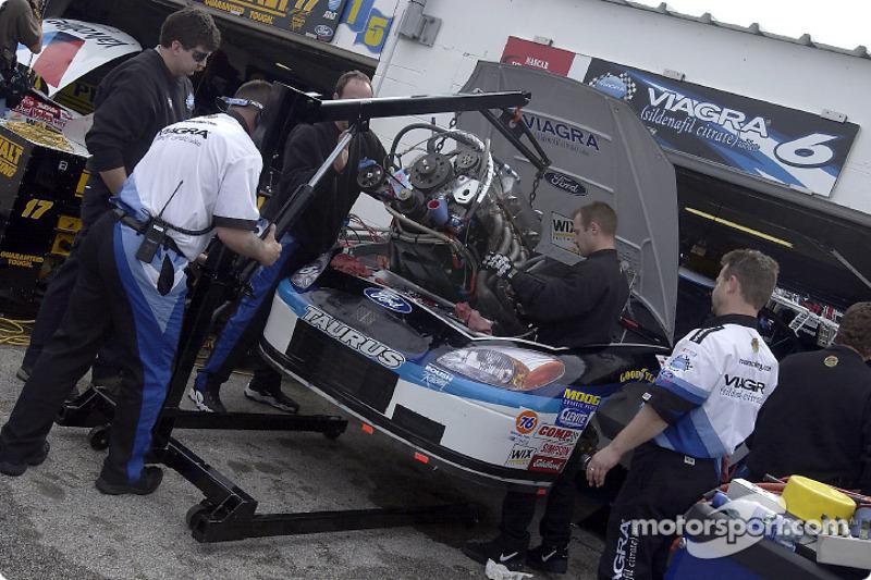 The Viagra Ford Taurus of Mark Martin undergoes an engine change in the Daytona garage area