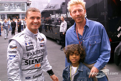Boris Becker and his son Noah visiting David Coulthard and the McLaren Mercedes team