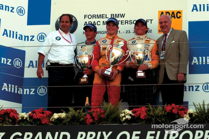Formula BMW ADAC Championship 1st heat winner Hannes Neuhauser, Christian Mamerow and Nico Rosberg, with Gerhard Berger