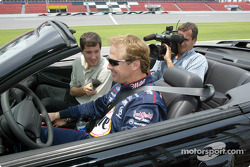 Rusty Wallace gives an interview with a local station before giving the reporter and cameraman a ride around Daytona's road course