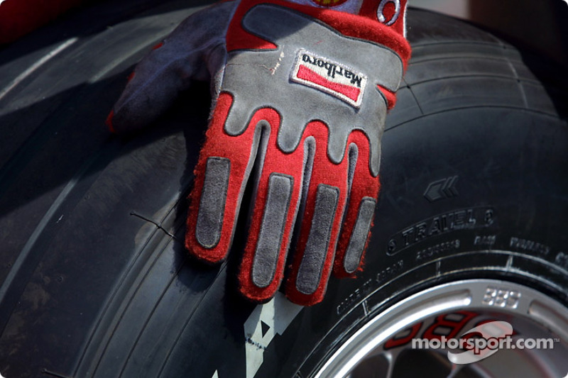 Gloved hand on tire