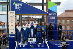 The podium: winner Marcus Gronholm with Richard Burns and Petter Solberg