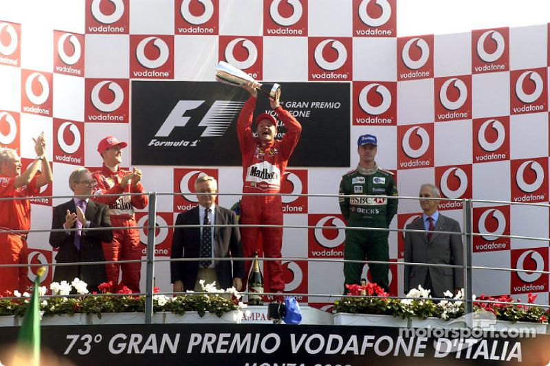 The podium: race winner Rubens Barrichello with Michael Schumacher and Eddie Irvine