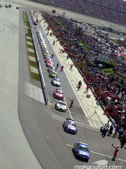 The cars pulling out onto the track