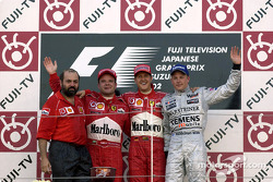 The podium: race winner Michael Schumacher with Rubens Barrichello and Kimi Raikkonen
