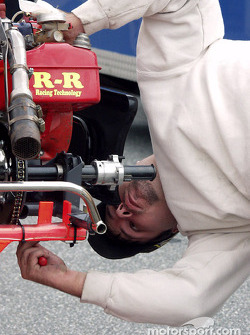 Rodney J. Harrington Pro Race driver Chip Disharoon bolts on his R&R Racing Technology motor before the feature
