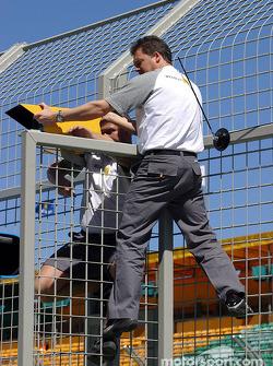 Renault crew members prepare pit wall area