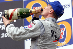 The podium: champagne for race winner David Coulthard
