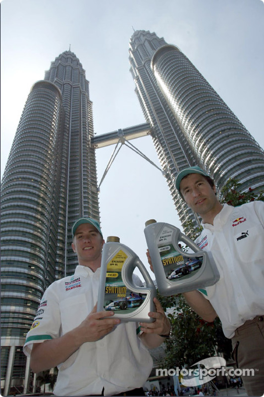 Nick Heidfeld and Heinz-Harald Frentzen in front of the Petronas Twin Towers