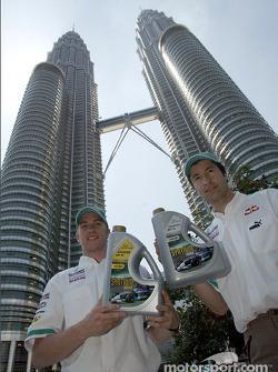 Nick Heidfeld and Heinz-Harald Frentzen in front of the Petronas Twin Towers