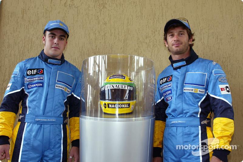 Visit of the Ayrton Senna Renault Factory in Curitiba: Fernando Alonso and Jarno Trulli with Ayrton Senna's helmet