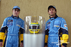 Visit of the Ayrton Senna Renault Factory in Curitiba: Fernando Alonso and Jarno Trulli with Ayrton Senna's helmet