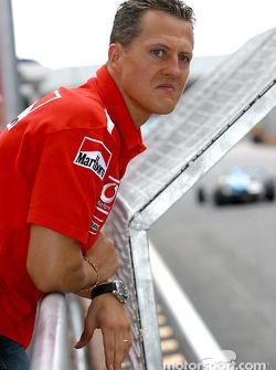 Michael Schumacher watches support races