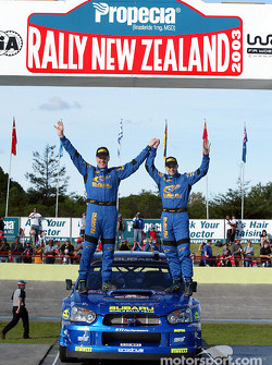 The podium: Petter Solberg and Phil Mills celebrate third place