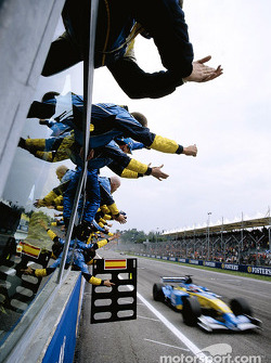 Fernando Alonso crosses the finish line