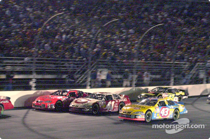 Three wide on the back stretch