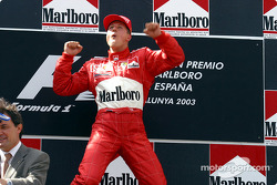 The podium: race winner Michael Schumacher celebrates